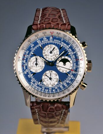 written date: Luxury watch on  studio background. The Breitling Navitimer 1993 ref: H2902 in gold edition is extremely rare