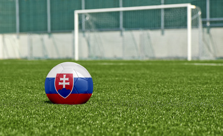 b ball: Soccer ball with the flag from Slovakia on the green field