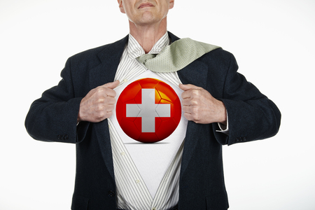 fully unbuttoned: Superhero pulling Open White Shirt with soccer ball flagged Switzerland on white background Stock Photo
