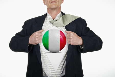 fully unbuttoned: Superhero pulling Open White Shirt with soccer ball flagged Italy on white background