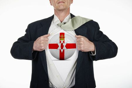 changing form: Superhero pulling Open White Shirt with soccer ball flagged North Ireland on white background