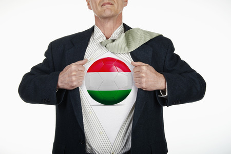 fully unbuttoned: Superhero pulling Open White Shirt with soccer ball flagged Hungary on white background