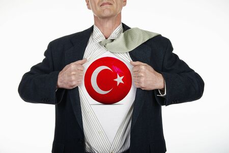 fully unbuttoned: Superhero pulling Open White Shirt with soccer ball flagged Turkey on white background Stock Photo