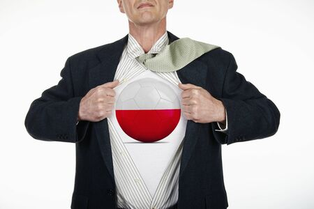 fully unbuttoned: Superhero pulling Open White Shirt with soccer ball flagged Poland on white background Stock Photo