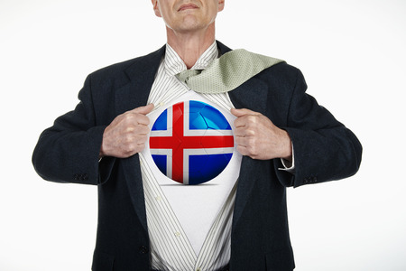 fully unbuttoned: Superhero pulling Open White Shirt with soccer ball flagged Iceland on white background