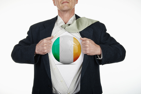 fully unbuttoned: Superhero pulling Open White Shirt with soccer ball flagged Ireland on white background