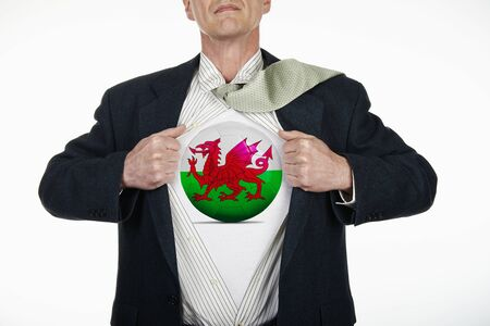 b ball: Superhero pulling Open White Shirt with soccer ball flagged Wales on white background