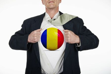 fully unbuttoned: Superhero pulling Open White Shirt with soccer ball flagged Romania on white background