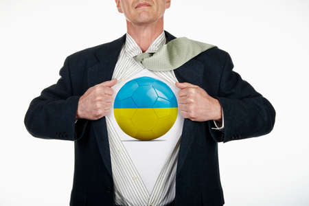 fully unbuttoned: Superhero pulling Open White Shirt with soccer ball flagged Ukraine on white background