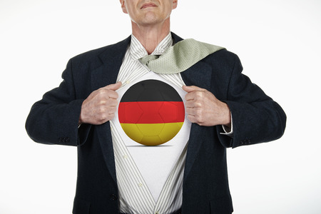 fully unbuttoned: Superhero pulling Open White Shirt with soccer ball flagged Germany on white background