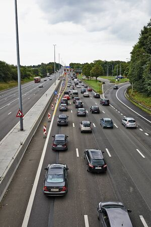 car lots: BERTEM, BELGIUM - AUGUST 12, 2014: Picture shows lots of car stucked in Bertem cloverleaf, on the highway E40, as works in august 2014