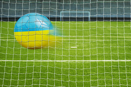 penalty flag: Shot on goal, soccer ball with the flag of Ukraine in the net Stock Photo