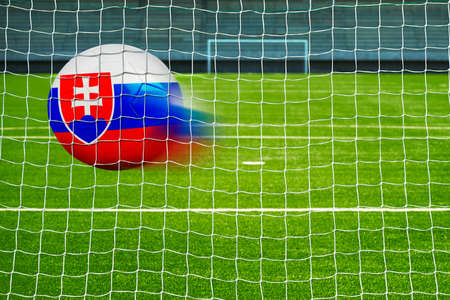 penalty flag: Shot on goal, soccer ball with the flag of slovakia in the net