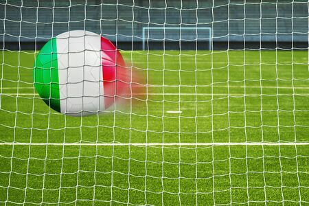 penalty flag: Shot on goal, soccer ball with the flag of Italy in the net Stock Photo