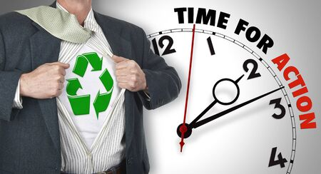 allow: Businessman showing superhero suit with recycling symbol underneath his shirt standing against clock with time for action - path for the shirt