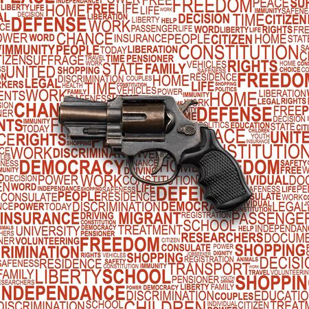 liberties: Revolver Gun, toy for children with background concept wordcloud of human rights