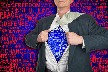 liberties: Businessman showing superhero suit underneath his shirt standing against human rights background Stock Photo