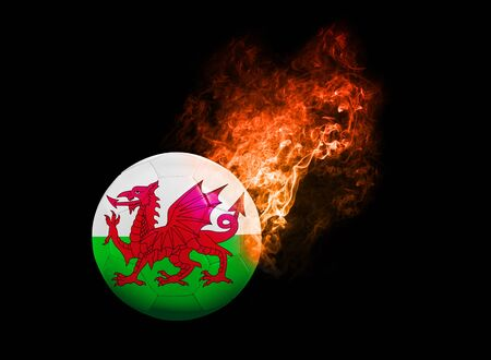 b ball: Flaming Football Ball on black background with team flags, Europe 2016. Group B, Wales