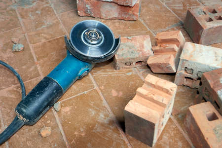 bricklayer: Saw for bricklayer laying on the ground Stock Photo