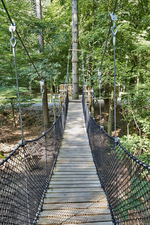 suspension bridge in the forest of the natural reserve in Han-sur-Lesse, Belgium Stock Photo