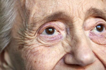 Detail portrait of an elderly women on black background