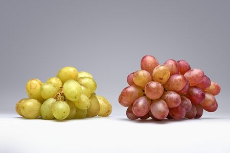 fungicide: Two sorts of grapes with gray gradient for background