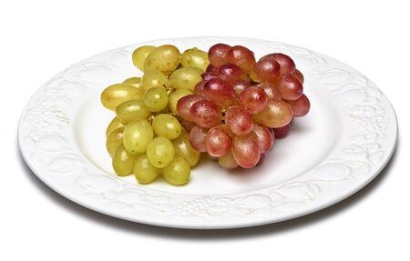 fungicide: Two sorts of grapes, freshly washed on an old plate isolated on white with clipping path