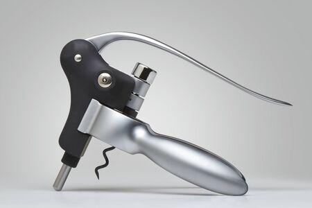 Closeup of a modern metal cork screw on Gray background Stock Photo