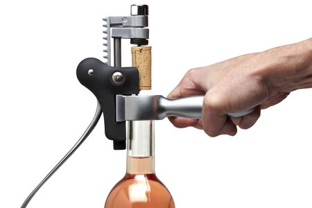 Closeup of a man hand using modern metal cork screw for pulling the cork from a rose wine bottle. Clipping path Stock Photo