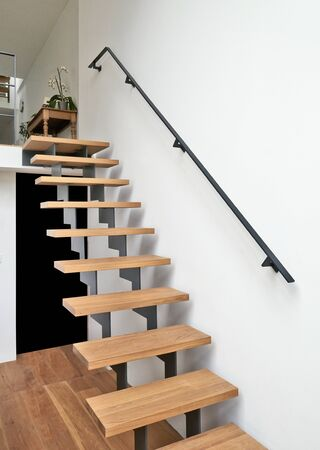 duplex: Hardwood stairs and ramp in modern renovated living room