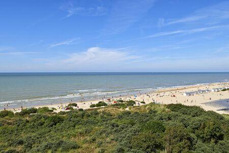 DE PANNE, BELGIUM - JULY 06, 2016: Lot of people enjoy the Belgian Coast in Summer at De Panne, Belgium