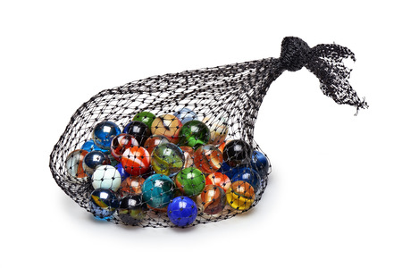 Bag of Multicolored marbles isolated on white background