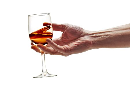 Pink wine swirled in glass on white background with clipping path Stock Photo