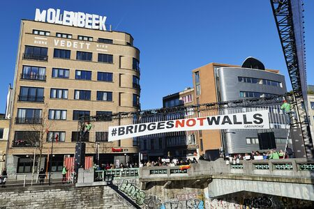 organise: BRUSSELS, BELGIUM - January 20, 2017: Greenpeace organise demonstration for Bridges Not Walls: anti-Trump protesters have dropped banners on the bridge between Molenbeek and Brussels center