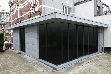 New modern extension of a house with big glasses windows and doors Standard-Bild
