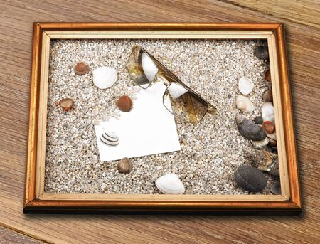 tableau: Shells, starfish ,blank paper sheet ,sunglasses and frame