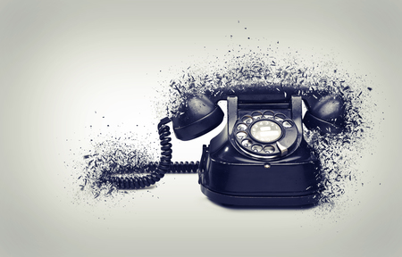 Old and vintage telephone shattered Stock Photo
