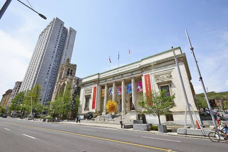 chagall: MONTREAL, QUEBEC, CANADA - 18 MAY 2017: Sherbrooke Street West with the Facade of the Montreal Museum of Fine Art, church and building.
