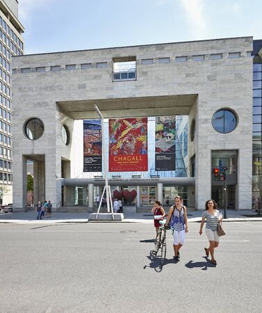 chagall: MONTREAL, QUEBEC, CANADA - 18 MAY 2017: Some people walking on Sherbrooke Street West with the Facade of the Montreal Museum of Fine Art, church and building. Editorial