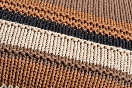 Close-up on the texture in wool from a sepia pull over