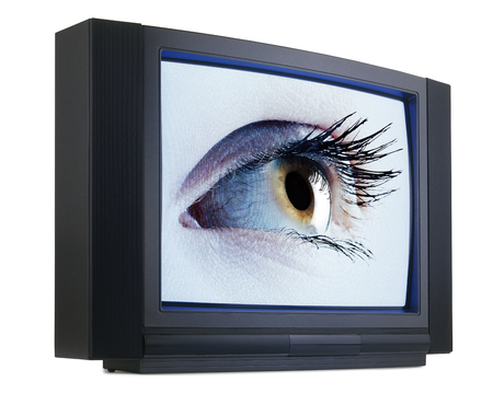 Old fashioned television with green iris eyes isolated on white with clipping path Stock Photo