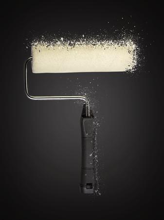 Paint roller shattered on black background
