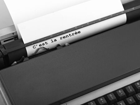 Typewriter, concept of Online News. Back to school in French words