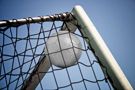 Soccerball in net ready for championship