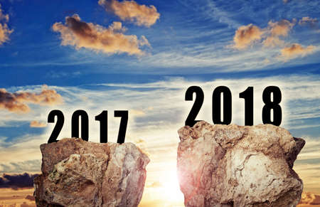 Big rock floating against sunset background for the new year 2018