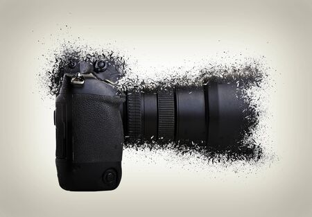 One black camera shattered on white background. side view