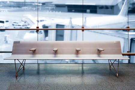 Airport departure lounge, airplane in the blurred background, summer vacation concept, Airport terminal waiting area