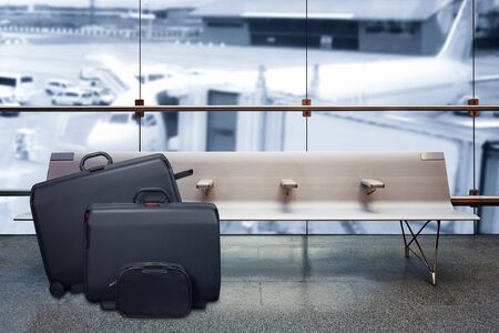 Airport departure lounge, airplane in the blurred background, summer vacation concept, traveler suitcases in airport terminal waiting area Lizenzfreie Bilder