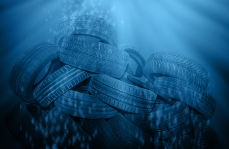 Pile of old black tires polluted deep blue sea