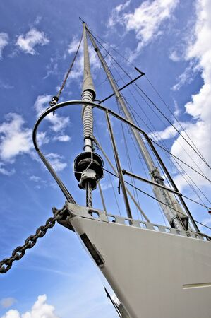 Nautical vessel bow against cloudy blue sky